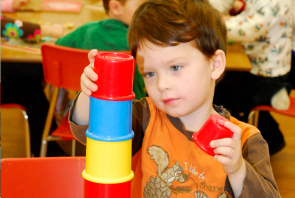 Boy playing with blocks during our half day pre-school in Burlington